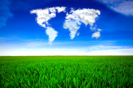 Cloud formation in the shape of a map of the world, over a green field